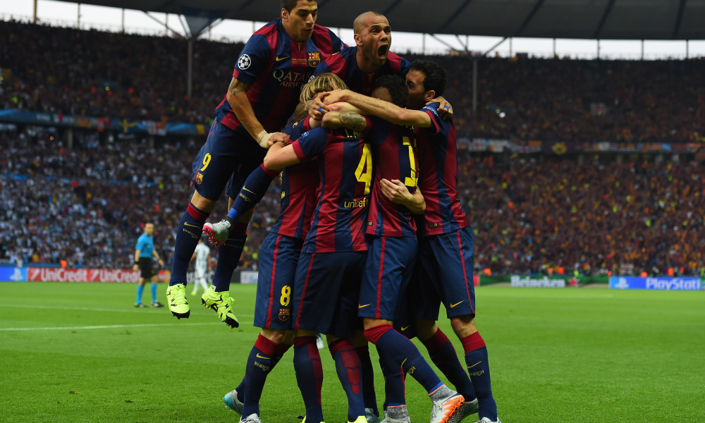 BERLIN, GERMANY - JUNE 06: Luis Suarez and Daniel Alves of Barcelona celebrate with team mates after the goal scored by Ivan Rakitic during the UEFA Champions League Final between Juventus and FC Barcelona at Olympiastadion on June 6, 2015 in Berlin, Germany.  (Photo by Shaun Botterill/Getty Images) ORG XMIT: 554887045 ORIG FILE ID: 476113286